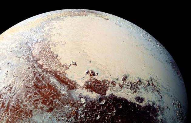 科学家们相信,在冥王星的冰?#28526;?#23618;之下存在一个地下海洋。
