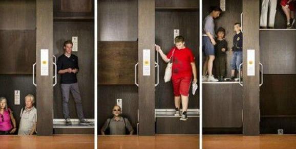 神奇的电梯 没门也不停逮准机会蹿上去就行